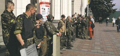 Matt Schofield/MCT files Volunteer security forces gather in front of the Ukrainian Rada, or parliament, in Kiev.