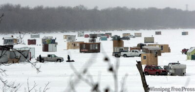 Ice fishing shacks on the Red River south of Selkirk.