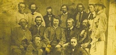 A photo of Louis Riel (middle row, centre) with his councillors, circa 1869. It's one of eight photos sold to the U of M.