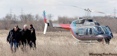 Premier Greg Selinger (right) and Manitoba Fire commissioner Chris Jones flew over the Assiniboine River on Monday.