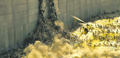 Jaap Buitendijk / Paramount picturesZombies scramble over each other to scale a wall.