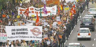 Protesters holding banners reading 'We don't owe, we won't pay' march against austerity measures announced by the Spanish government in Madrid, Spain, on Oct. 13.