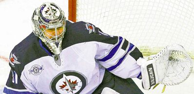 Winnipeg Jets goalie Ondrej Pavelec (31), of the Czech Republic