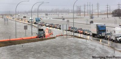 Northbound traffic on I-29 is backed up three kilometres at Harwood, N.D., just north of Fargo, due to overland flooding on Sunday.