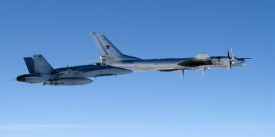 A CF-18 jet escorts a Russian bomber out of Canadian airspace in the high Arctic. Such encounters have become more common in the last decade.