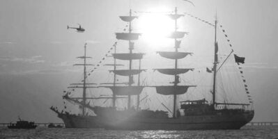 The tall ship Gayas at anchor with other tall ships off Virginia Beach.