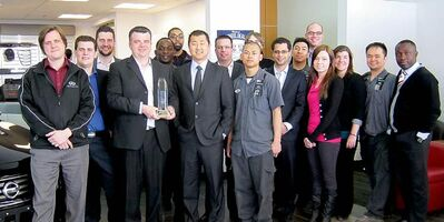 Birchwood Nissan staff with Award of Excellence. General manager Christian Goleski holds the award.