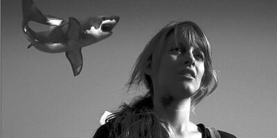 It's a bird! It's a plane! It's a tornado made of sharks! Aubrey Peeples as Claudia in Sharknado.