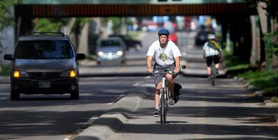 Cyclists are seen on the Assiniboine bikeway in a file photo.