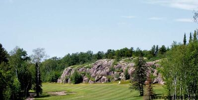 The 13th hole of the Granite Hills Golf Course, near Lac Du Bonnet.  Nowhere else in Manitoba can you blast a drive into a 10-metre rock face and carom it towards the green.
