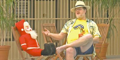 Sitting with his good buddy, Santa, Doug Speirs regales us with tales of relatively balmy weather ahead.