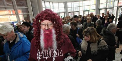 Curling fan Hans Madsen of Yorkton, Sask., dressed in the unofficial colour of the Roar of the Rings tournament, burgundy, waits in line to enter the MTS Centre for the opening ceremonies Sunday morning.