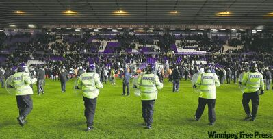 simon dawson / the associated press archivesBirmingham City fans confront Aston Villa fans and the police after winning their English League Cup quarter-final match at St. Andrews stadium in Birmingham on Dec. 1, 2010.
