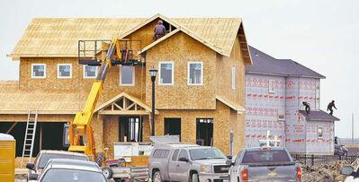 New homes are going up in Bridgwater Lakes south of Winnipeg. The latest forecast from Canada Mortgage and Housing Corp. predicts the average selling price of an existing home in Manitoba will rise faster than anywhere else in 2013, at 3.9 per cent.