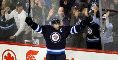 Winnipeg Jets captain Andrew Ladd  celebrates his goal -- the team's third -- Thursday at the MTS Centre.