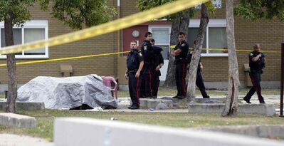 Police investigate at Lord Selkirk Park, a Manitoba Housing project common area on Robinson Street, that left one person dead.