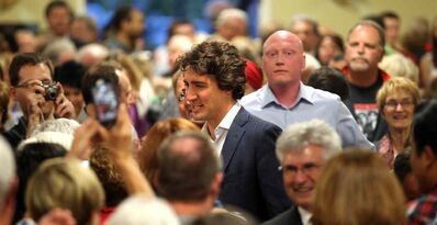 A standing-room-only crowd greets Liberal Leader Justin Trudeau in Lorette on Sept. 25.