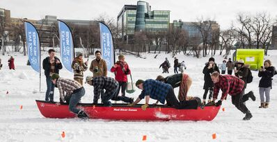 Contestants take part in the first annual Wild Winter Canoe Race at The Forks on Louis Riel Day.