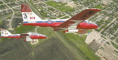 Melissa Tait / Winnipeg Free PressThe Canadian Forces Snowbirds fly in formation, under low cloud cover north of Winnipeg on Saturday.