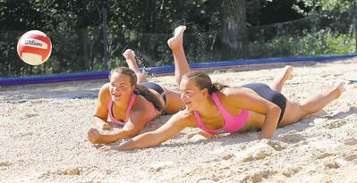 Fifteen-year-old twin sisters Josie (left) and Kearley Abbott won the first beach volleyball tournament they entered, last weekend in Toronto.