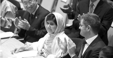 UN Secretary-General Ban Ki-moon (left) and UN members applaud Malala Yousafzai (centre).