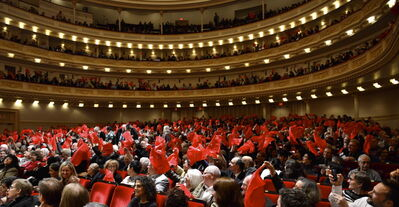 Fans wave a traditional red flags at the concert.