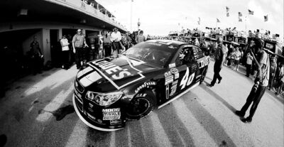 Terry Renna / the associated pressJimmie Johnson drives through the garage area during practice for today�s NASCAR Sprint Cup race in Homestead, Fla.