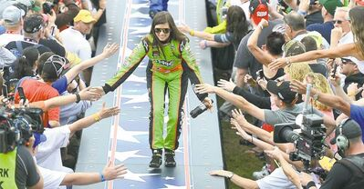 Danica Patrick slaps hands with fans as she is introduced prior to the Daytona 500 on Feb. 24. Patrick claimed the pole for the race, but didn't win.