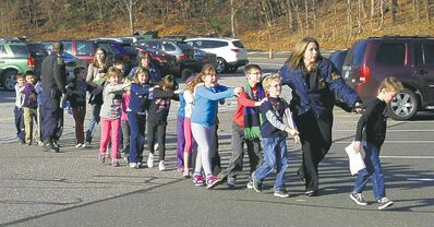 Shannon Hicks / Newtown Bee / The Associated Press