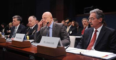 From left, Deputy Director of the National Security Agency Chris Inglis, Director of the National Security Agency Gen. Keith Alexander, Director of National Intelligence James Clapper, and Deputy Attorney General James Cole testify during a hearing before the House (Select) Intelligence Committee October 29, 2013 on Capitol Hill in Washington, DC.