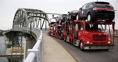 In this June 1, 2009 file photo, a truck loaded with Ford and Lincoln vehicles are transported from Canada to the U.S. Peace Bridge border crossing in Buffalo, N.Y. A U.S. congressman says Canadians should not be overly concerned about a proposed border crossing fee, saying it just isn't going to happen.Democratic representative Brian Higgins, who is from the border city of Buffalo, N.Y., told CTV's Question Period on Sunday that he has a lot of allies in the U.S. Congress who will stop any legislation that includes a fee.THE CANADIAN PRESS/AP/David Duprey