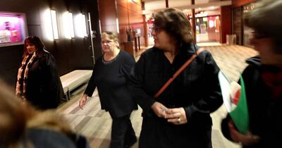 Debbie DeGale (second from left) walks out of the Sinclair hearing Monday evening after stating her reports were changed by her superiors.