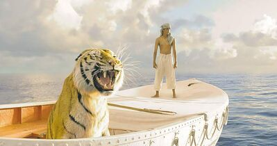 "This film image released by 20th Century Fox shows Suraj Sharma in a scene from ""Life of Pi."" A twisty tale of time travel, the magical story of a boy lost at sea and the return of James Bond are among the year's Top 10 films as selected by the writers and editors of The Canadian Press. THE CANADIAN PRESS/AP,20th Century Fox, Jake Netter"