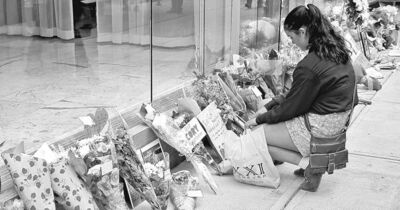 Darryl Dyck / The Canadian PressA fan pauses after placing flowers at a memorial for actor Cory Monteith outside the Vancouver hotel where he died.
