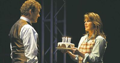 Lyon offers birthday cake to Wright, even though it is no one's birthday in Next to Normal.
