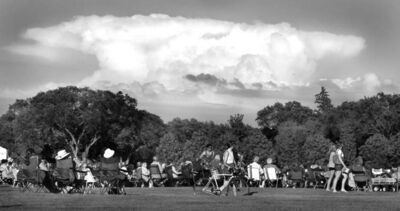 East of the city, a massive storm cloud rises above the assembled ballet fans at Assiniboine Park for Ballet in the Park's opening night. STAND UP. July 25, 2012 - (Phil Hossack / Winnipeg Free Press)