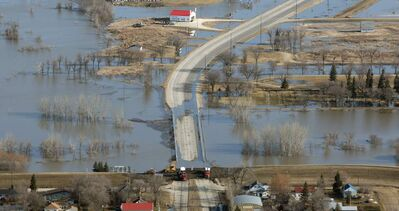 The closed Highway 75 at Morris, as crews close the community's ring dike Wednesday.
