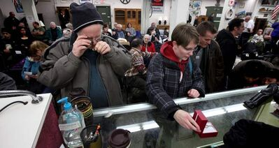 Bidders take a close look at the goods.