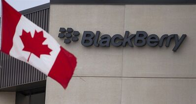 A Canadian flag flies at BlackBerry's headquarters in Waterloo, Ont., July 9, 2013. THE CANADIAN PRESS/Geoff Robins