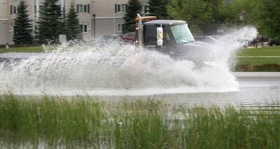 A truck hits a large puddle on Waverley St. near Wilkes Ave. after a heavy rain fall Thursday evening. Wayne Glowacki/Winnipeg Free Press August 22 2014
