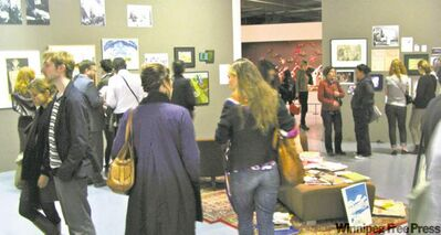 Parisians take in the My Winnipeg exhibit at the Maison Rouge Gallery.