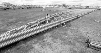 A large metal truss sits assembled in a field at Behlen Industries as a mock-up for an order destined for Russia.