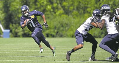 Elaine Thompson / The Associated PressWide receiver Percy Harvin (left) has been flying around at Seahawks workouts,  showing off his blazing speed.