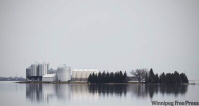 A farm is surrounded by Red River flood water, just south of St. Jean Baptiste on Tuesday.