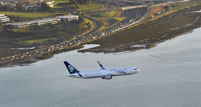In this July 13, 2009 photo released by Air New Zealand via New Zealand Herald, a Air New Zealand Boeing 767 approaches to land at Auckland international airport. The country's flagship airline plans to open a new frontier by flying planes to Antarctica and land on an ice runway. But tourists wanting to travel to the frozen continent will need to keep their hopes in check. The chartered flights would be for scientists and their support crews, and the airline said Tuesday it has no plans to begin commercial trips. (AP Photo/Air New Zealand via New Zealand Herald) AUSTRALIA OUT, NEW ZEALAND OUT