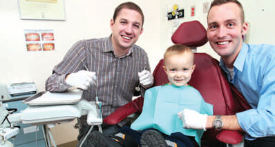 Dr. Nick Lekic (left) with patient Daniel Kehler, and Dr. Brad Klus at the Children's Dental Clinic. (Source: WAVE magazine, Nov/Dec 2011.)