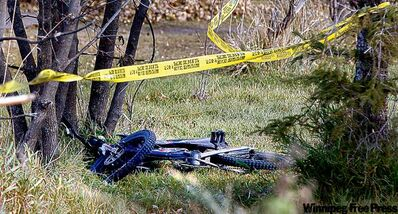 A bike lies in the yard at the boy's family home on Sagkeeng First Nation.
