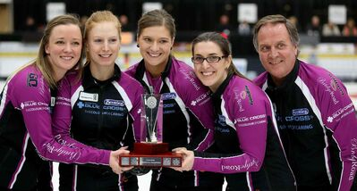 Chelsea Carey and her rink, Kristy McDonald, Kristen Foster, Lindsay Titheridge and coach Dan Carey pose for photos after defeating Kerri Einarson in the final of the Scotties Provincial Curling Championship.