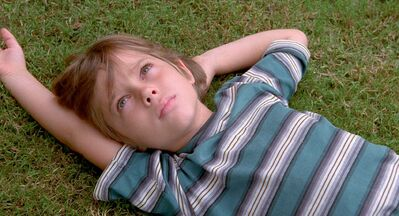 PHOTOS FROM IFC FILMSWhile Ellar Coltrane�s Mason is portrayed from age six to 18, director Linklater doesn�t resort to cheap sentiment or coming-of-age story clich��.