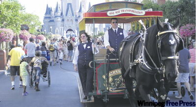 Main Street in the Magic Kingdom is always busy with people, parades and Disney vehicles.